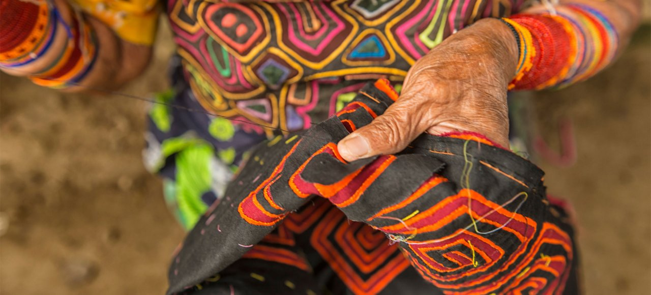 11A Kuna woman is sewing Mola, the traditional textile craft of the San Blas Islands in Panama
